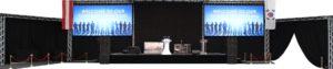 große Bühne mit zwei LED-Wänden und weiterer Eventtechnik und weißem Stehtisch